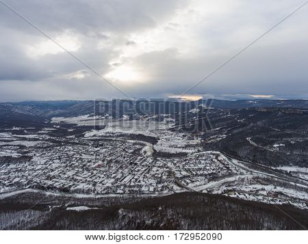 Aerial view of the village in the valley. Winter landscape.
