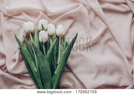 Instagram Spring Flat Lay. Stylish White Tulips On Beige Soft Fabric On Rustic Table Background Top