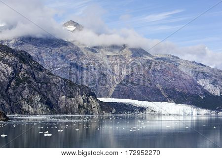 The scenic view of a glacier and mountains in Glacier Bay national park.