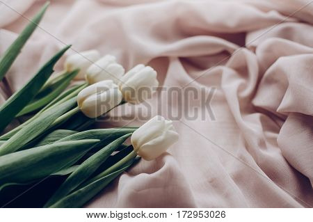 Instagram Spring Photo. Stylish White Tulips On Beige Soft Fabric On Rustic Table Background. Soft L
