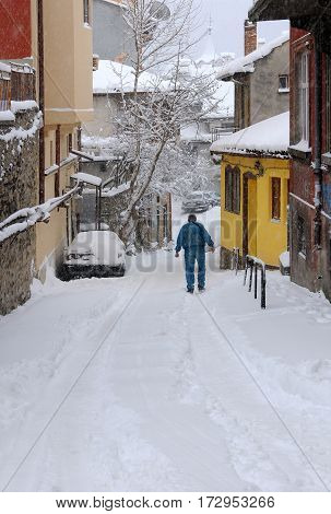 VELIKO TARNOVO BULGARIA - JANUARY 6 2017: Man in the lane in the Old Town in January