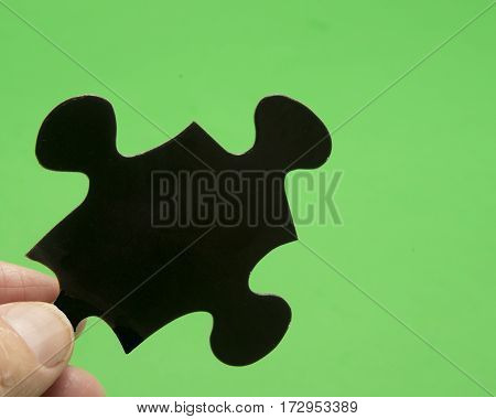 Black shape used for a puzzle picture
