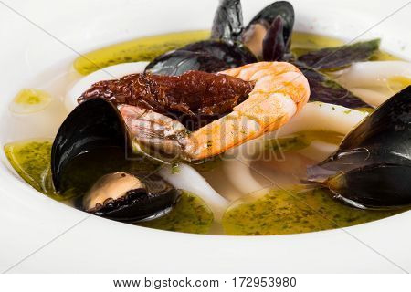 Delicious mediterranean seafood soup. Tasty fish soup with cod, shrimp, mussels and other molluscs. Spicy french soup bouillabaisse with seafood. Traditional in France and Spain.