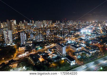 Aerial stock photo of Honolulu Hawaii at night