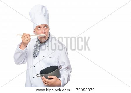 Cook Eat Cereal From The Pan With A Wooden Spoon On A White Background
