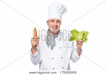 Portrait Of A Happy Cook With Fresh Vegetables In The Hands On A White Background