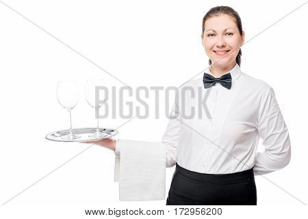 Woman waiter with two empty glasses on a tray on a white background