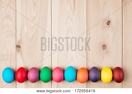 A Series Easter Eggs And A Wooden Background For An Inscription