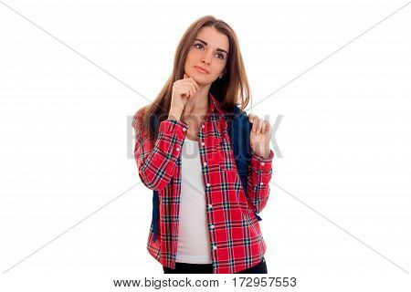 beautiful stylish student girl with backpack on her shoulders posing isolated on white