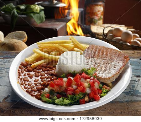 rice, beans, meat, chips and salad
