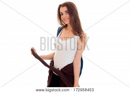 cheerful stylish student girl with backpack on her shoulders smiling on camera isolated on white