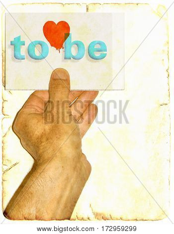 Male hand holds up sign with word