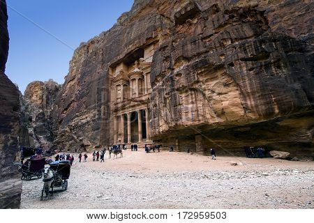 JORDAN, Ancient Petra - 10 JANUARY 2017:Tourist complex of the ancient city of Petra with tourists and locals: JANUARY 10, 2017 in Jordan. Ancient Petra