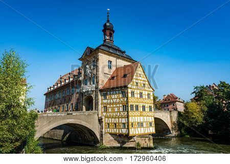 BAMBERG, GERMANY - Circa September, 2016: Old historic baroque Town Hall, Bamberg, Germany with its timbered frescoed walls built on an island in the Regnitz River accessed by two arched stone bridges