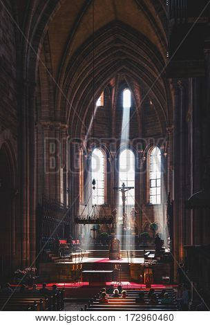 BAMBERG, GERMANY - Circa September, 2016:Beams of sunlight shining through the windows lighting up the altar in the historic Bamberg Cathedral, Germany creating a beautiful spiritual effect