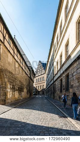 BAMBERG, GERMANY - Circa September, 2016: Narrow road near cathedral square in Bamberg, Germany with historic buildings