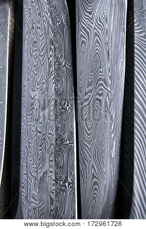 Damascus steel blade of knife. closeup of wootz, blacksmith forging process