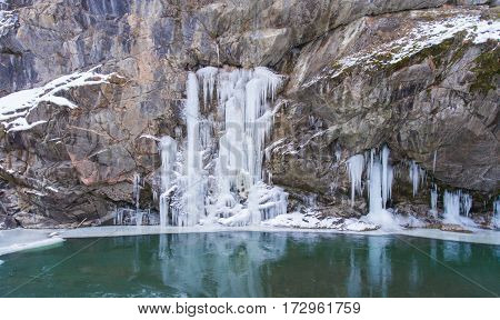 Aerial Landscape Frozen Waterfall Over The Lake
