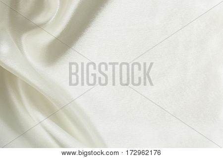 Closeup of white folded silk fabric for background
