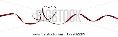 Red silk ribbon hearts and waves isolated on white for Valentine's day