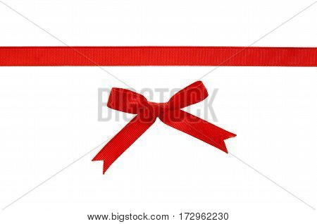 Red rep ribbon and bow isolated on white