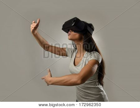 young attractive happy woman excited using 3d goggles watching 360 virtual reality vision enjoying cyber fun experience in vr simulation reality as if kissing a video lover