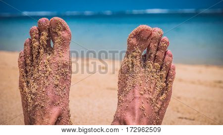 Male Feet at the Sandy Beach, Ocean in Background, Bali, Indonesia