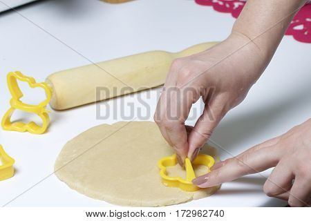 Preparation Of Baking Cookies At Home. On The Table Lay The Rolled Dough And Rolling Pin Wood. Near