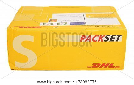 Caransebes Romania - December 16 2016: A DHL package isolated on a white background. Shot taken on December 16 2016