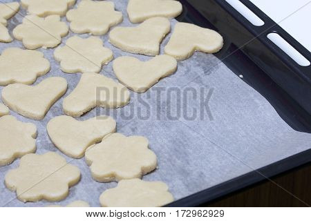 Preparation Of Baking Cookies At Home. Iron Pan Lined With Paper On Which Are Stacked Bars Of The Te