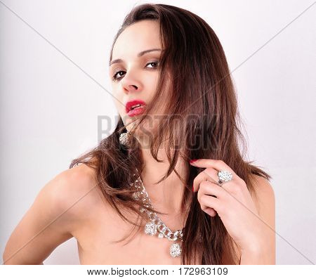 Beautiful fashion young woman with jewelry accessories