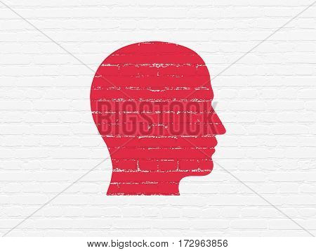 Advertising concept: Painted red Head icon on White Brick wall background