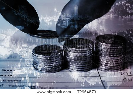 Double exposure hand with rows of coins and bill with city and account for finance banking Save money and business finance concept