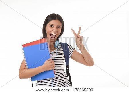 young beautiful and trendy latin student girl holding notepad folder and book carrying backpack smiling happy and confident in university and college education isolated on white background