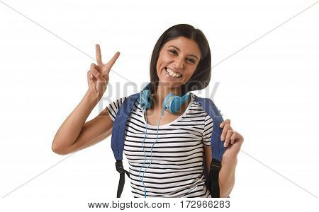 young beautiful and trendy latin student girl carrying backpack smiling happy and confident in university and college education isolated on white background doing hand sign peace