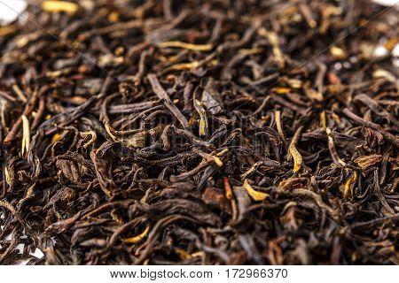 Premium quality Chinese black tea Dian Hong. Tea pattern background, tea macro photo.