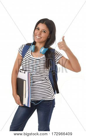 young beautiful and trendy latin student girl carrying backpack smiling happy and confident in university and college education isolated on white background giving thumb up