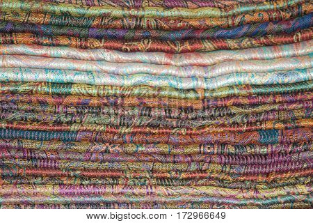 Background of Oriental cashmere stoles folded stack