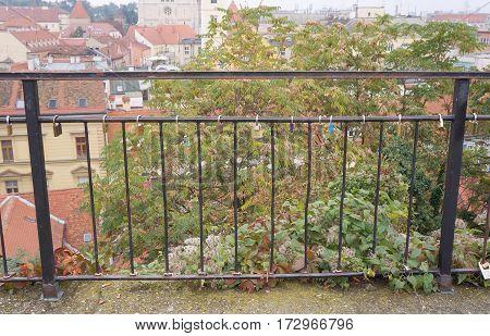 Love padlocks on the railing of the bridge, Zagreb, selective focus, blurred