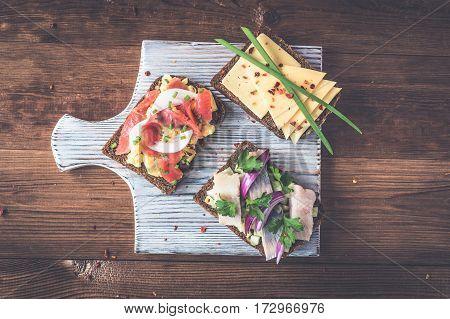Smorrebrod - danish open sandwich with fish herrin.