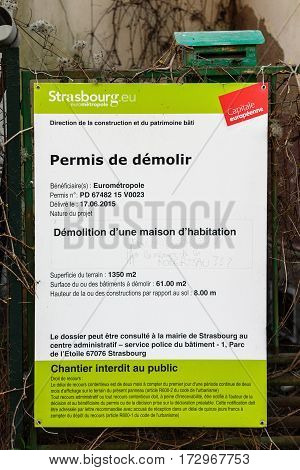 STRASBOURG FRANCE - APR 10 2016: House demolition permit issued by city hall on the wall of a house with the question added by neighobours ; Why? And what about the memory of the neighborhood of Robertsau?