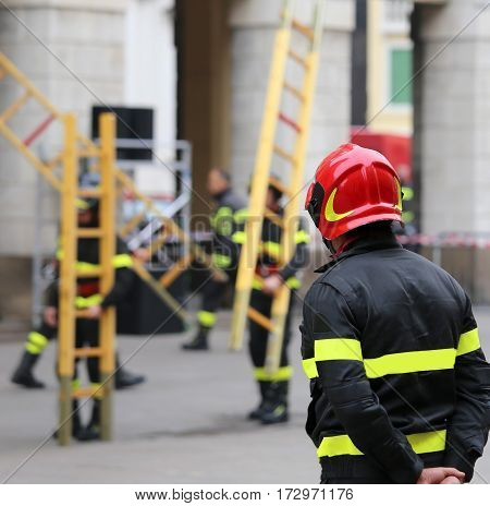 Firemen During Rescue Operations With A Wooden Ladder