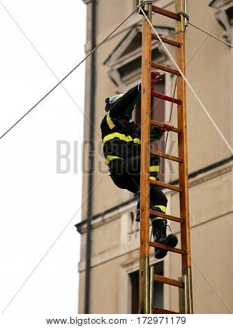 Fearless Firefighter Over A Wooden Stairs During A Fire-fighting