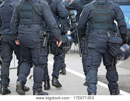 Police In Riot Gear With Protective Helmet Waiting For The Fans