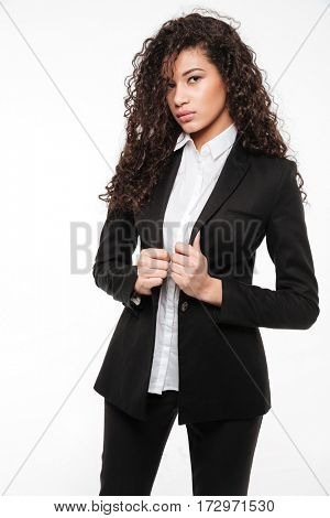 Portrait of confident african young businesswoman standing and posing over white background