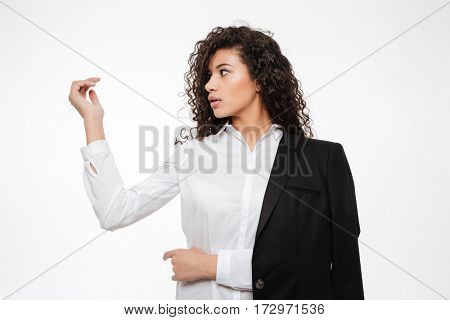 Beautiful african young businesswoman holding something in her hand over white background
