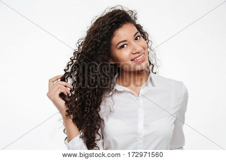 Portrait of happy curly african american young businesswoman over white background