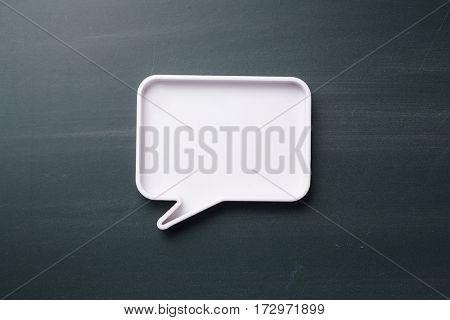 blank speech bubble on the blackboard