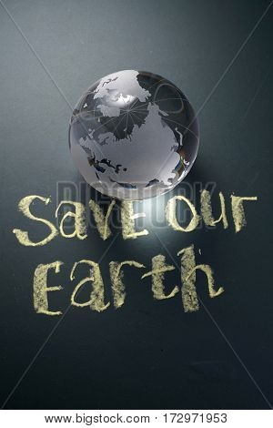 save the earth concept on the blackboard