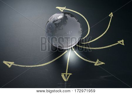 glass globe with arrows logistics concept